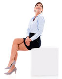 Thoughtful business woman sitting Royalty Free Stock Photography