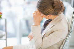 Thoughtful business woman sitting in office Royalty Free Stock Image