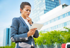 Thoughtful business woman with tablet pc Stock Photos