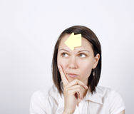 Thoughtful business woman with to do list Stock Image