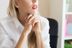 Thoughtful woman at work stock photo