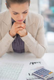 Thoughtful business woman working with documents Stock Photography