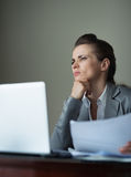 Thoughtful business woman working at hotel room Royalty Free Stock Photo