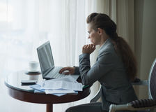 Thoughtful business woman working in hotel room Royalty Free Stock Image