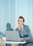 Thoughtful business woman working with laptop Stock Photos