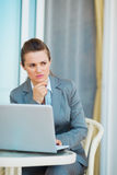 Thoughtful business woman working with laptop Royalty Free Stock Image