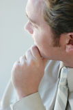 Thoughtful Businessman. Close up of one business man with hand on chin looking away Royalty Free Stock Images