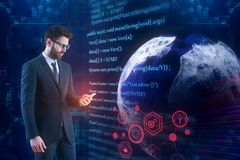 Worldwide computing and programming concept. Thoughtful businessman on abstract background with globe and HTML code. Worldwide computing and programming concept stock photography