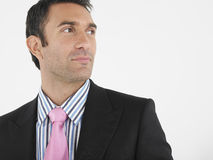 Thoughtful Businessman Against White Background Royalty Free Stock Photography