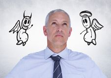 Thoughtful businessman with angel and devil doodle in background. Digital composition of thoughtful businessman with angel and devil doodle in background royalty free stock photo