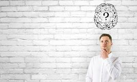 Thoughtful businessman with brain question royalty free stock images