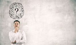 Thoughtful businessman with brain question stock photo