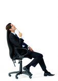 Thoughtful businessman in chair Royalty Free Stock Image