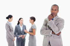 Thoughtful businessman with co-workers Stock Photography