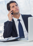 Thoughtful businessman having a phone call Royalty Free Stock Images