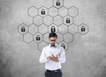 Thoughtful businessman with hexagonal lock security concept stock photos