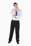 Thoughtful businessman with his hand on his chin Stock Images