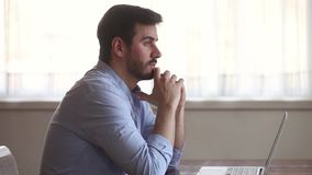 Thoughtful businessman lost in thoughts at work search for inspiration