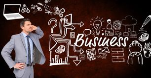 Thoughtful businessman with icons surrounding business text Royalty Free Stock Images