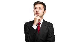 Thoughtful businessman isolated on white Stock Photos