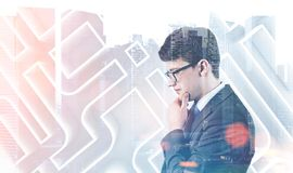 Thoughtful businessman in a labyrinth Stock Images