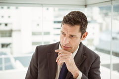 Thoughtful businessman looking away at office Royalty Free Stock Image