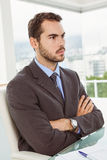 Thoughtful businessman looking away at office Stock Photography