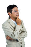 Thoughtful businessman looking away Royalty Free Stock Photo