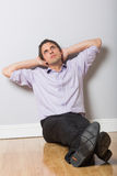 Thoughtful businessman looking up in an empty room Royalty Free Stock Photos