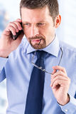 Thoughtful businessman making a phone call. Stock Images
