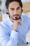 Thoughtful businessman making serious decision. Portrait of attractive young man thinking about his business. He is looking at camera pensively. Worker is Royalty Free Stock Photos