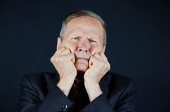 Thoughtful businessman. Man with fists near his mouth Stock Images