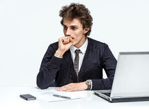 Thoughtful businessman at office desk. Royalty Free Stock Photos