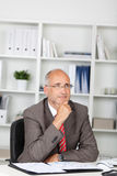 Thoughtful businessman in the office Royalty Free Stock Photography