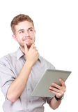 Thoughtful businessman portrait using tablet Stock Image