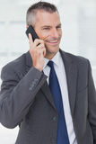 Thoughtful businessman posing while having a phone call Stock Images