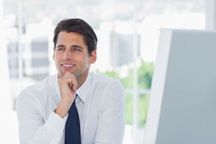 Thoughtful businessman posing looking away Stock Images