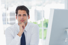 Thoughtful businessman posing looking at camera Stock Photo
