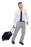 Thoughtful businessman posing with suitcase Stock Photography