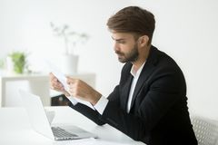 Serious businessman reading papers analyzing business strategies Stock Image