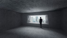 Thoughtful businessman standing in empty space concrete room royalty free stock photos