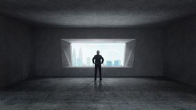 Thoughtful businessman standing in empty space concrete room royalty free stock photography