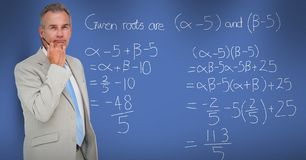Thoughtful businessman standing by math equation. Digital composite of Thoughtful businessman standing by math equation Stock Photo