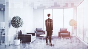 Finance and economy concept. Thoughtful businessman standing in toned interior with forex chart. Finance and economy concept. Double exposure Royalty Free Stock Image