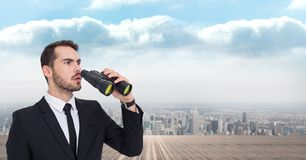 Thoughtful businessman using binoculars against city. Digital composite of Thoughtful businessman using binoculars against city Royalty Free Stock Photography