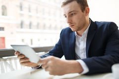 Thoughtful Businessman Using Digital Tablet Royalty Free Stock Images