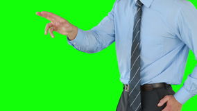 Thoughtful businessman using an invisible board stock video