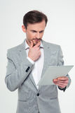 Thoughtful businessman using tablet computer Royalty Free Stock Photography