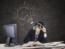 Thoughtful businessman wearing gas mask 3 Royalty Free Stock Images