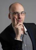 Thoughtful businessman wearing glasses Royalty Free Stock Photo